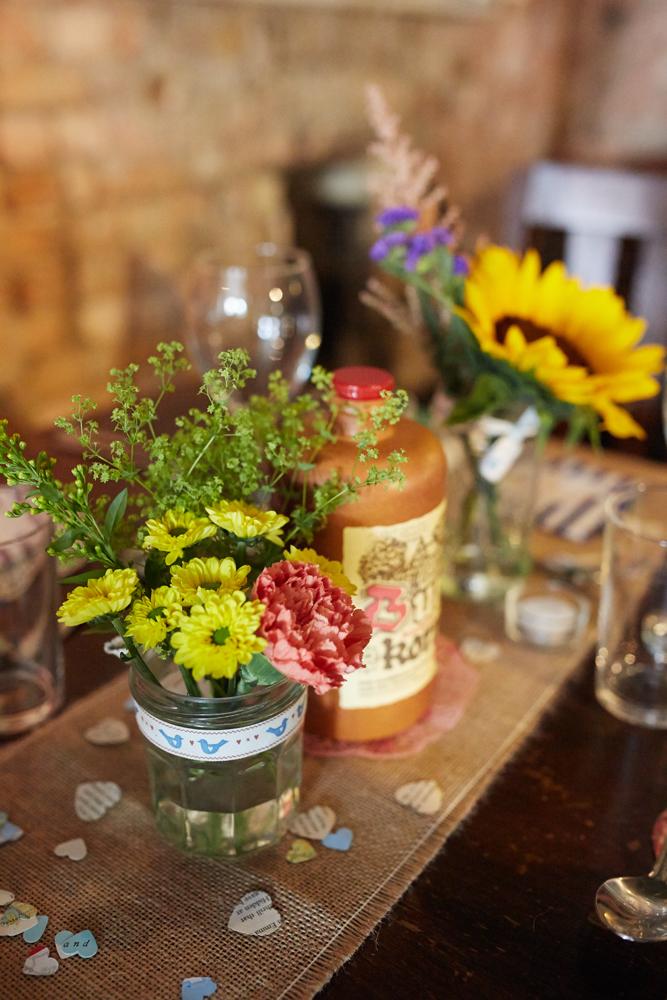 Rustic jam jar flowers