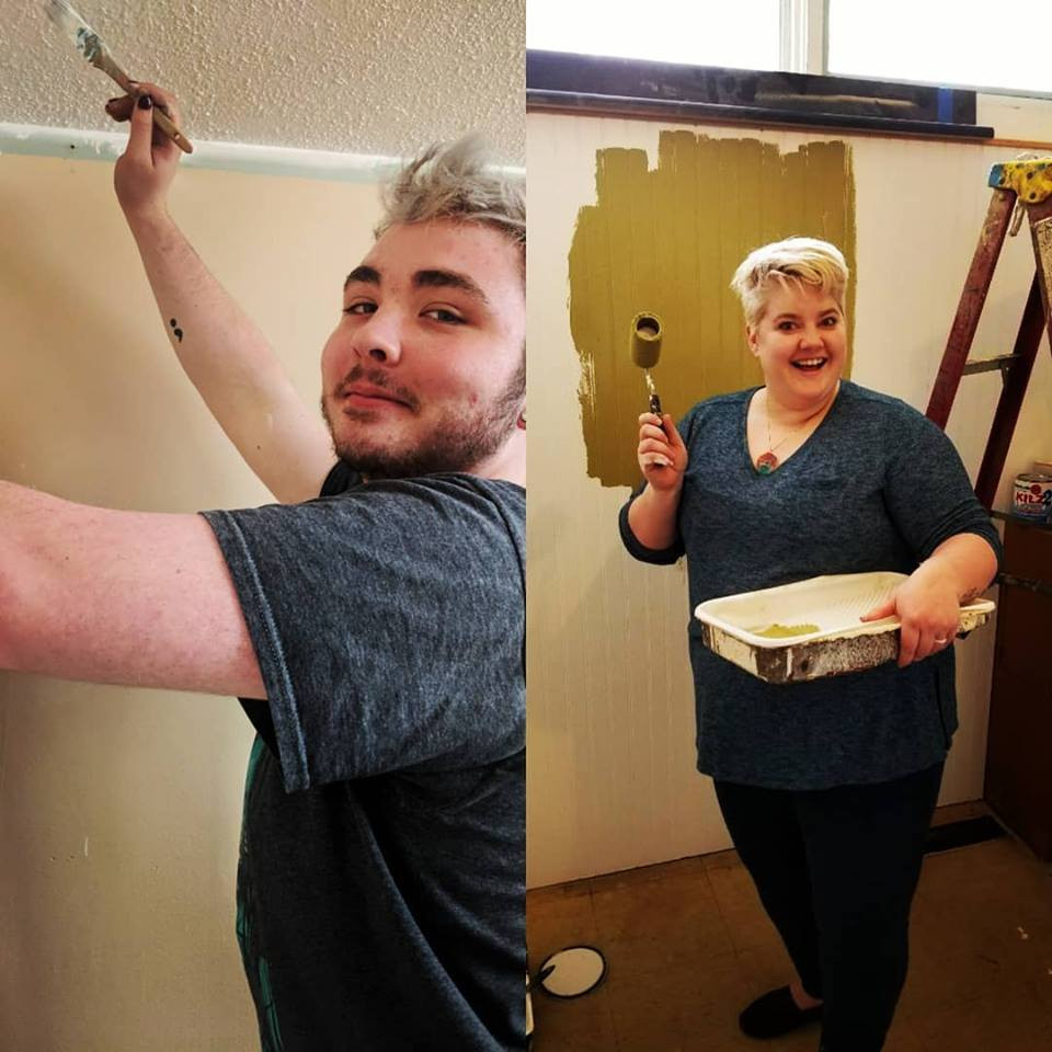 Tyler and Kristen painting local drop-in center for homeless aduls