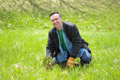 Keenan participating in a tree-planting event organized by Living Green Barrie