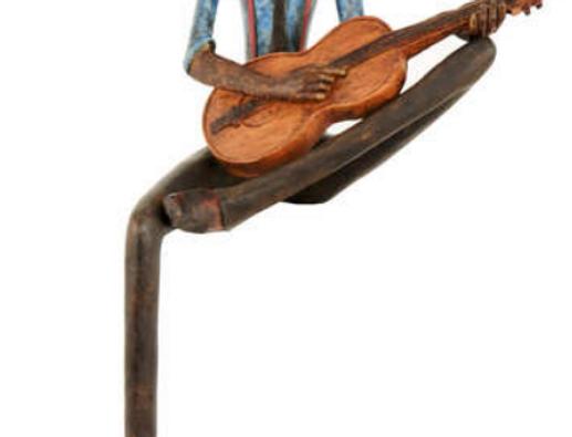 sitting string player