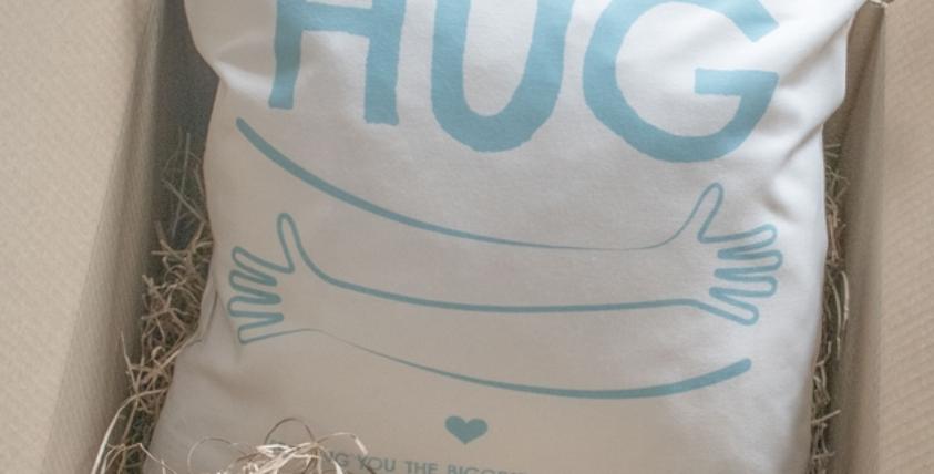 a hug by post cushion
