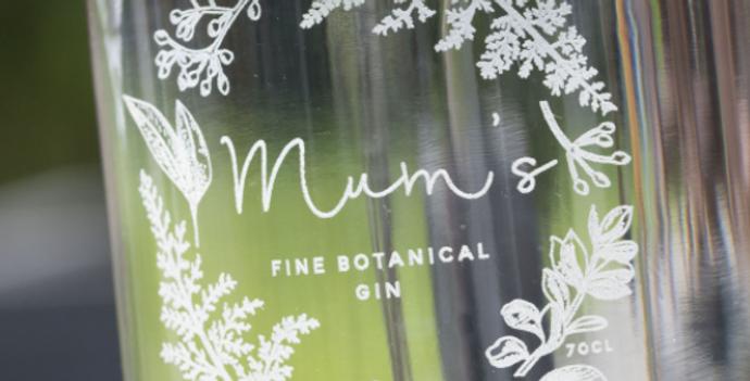engraved wreath design gin bottle