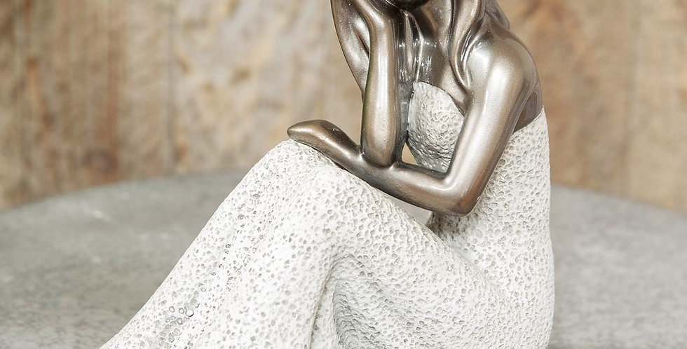 textured grey stone and silver lady figurine