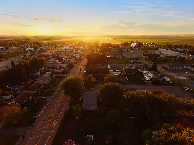 Aerial view of sunset on a small town.jp