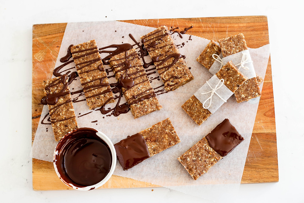 Flat lay of banana bread protein bars drizzled in chocolate