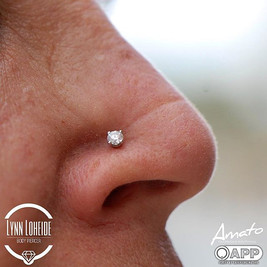 Well healed nostril piercing by me sporting a beautiful, sparkly 3mm genuine VS1 diamond f