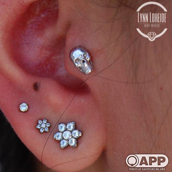 Fresh tragus with a white gold skull fro