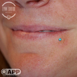 This Mint green cz was the perfect pop of color for this fresh labret piercing! #appmember