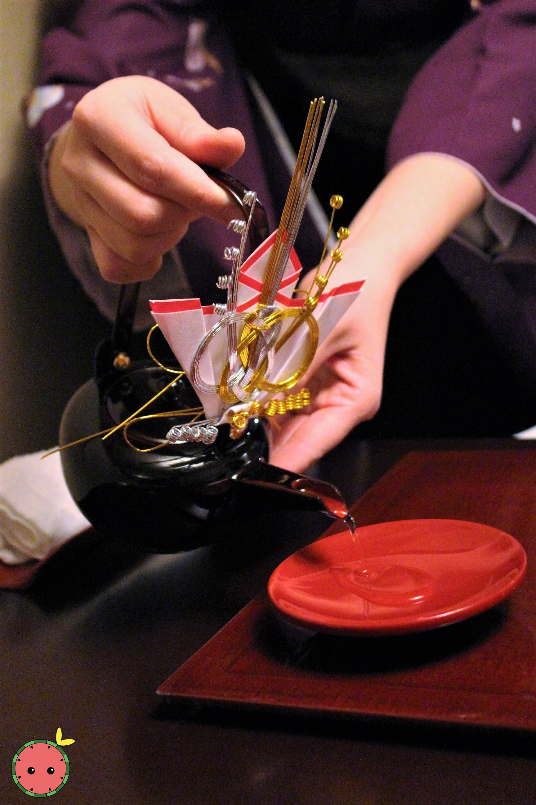 Pouring Isojiman Ginjo Genshu Sake