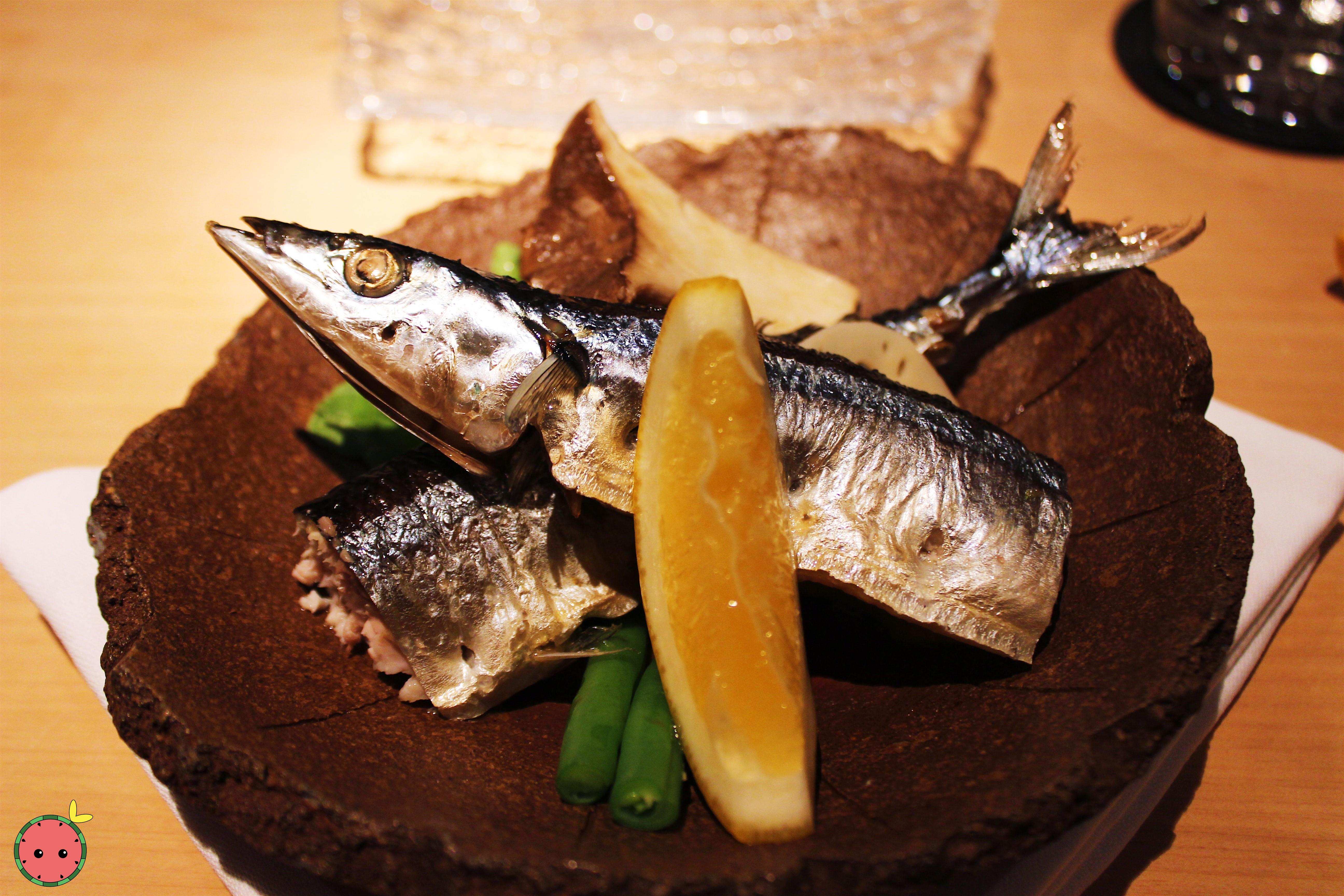 Soft broiled sanma (mackerel pike) from Japan with green beans, pickled lotus root, and king trumpet