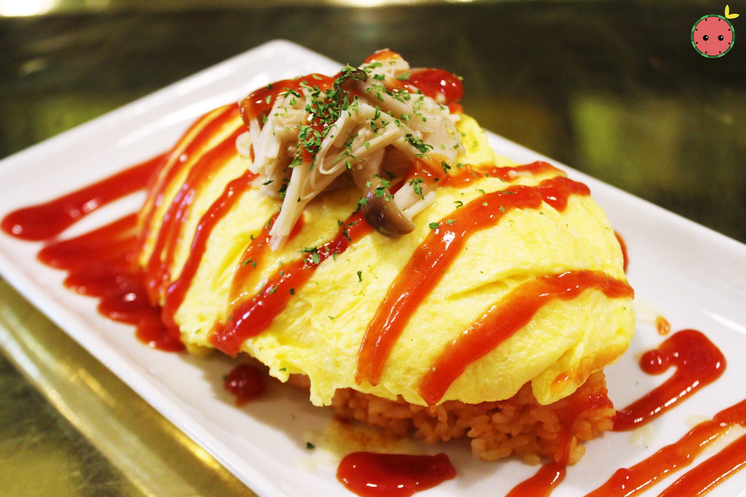 Omurice - Fluffy omelet with tomato sauce-seasoned pork rice with kinko mushrooms and melted cheese