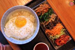 Kimchi Pork Bibim-Bap - Traditional korean rice dish with kimchi, pork, marinated vegetables, jidori