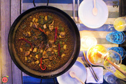 Valencian-Style Paella with Rabbit, Chicken, Flat Green Beans, Red Bell Peppers, & other Vegetables