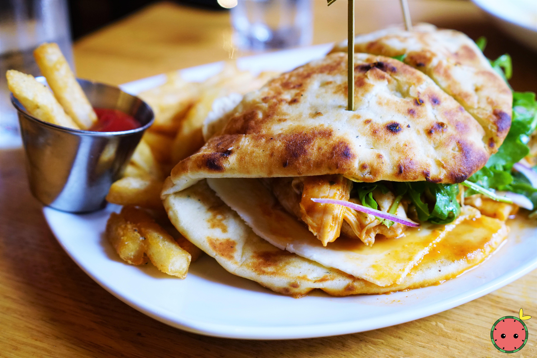 Chicken Tikka Sandwich with Masala Sauce, Red Onion, Arugula, Paneer, Garlic Naan, & Fries