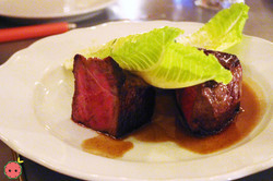 Strip Steak certified angus beef with potato dauphine and romaine