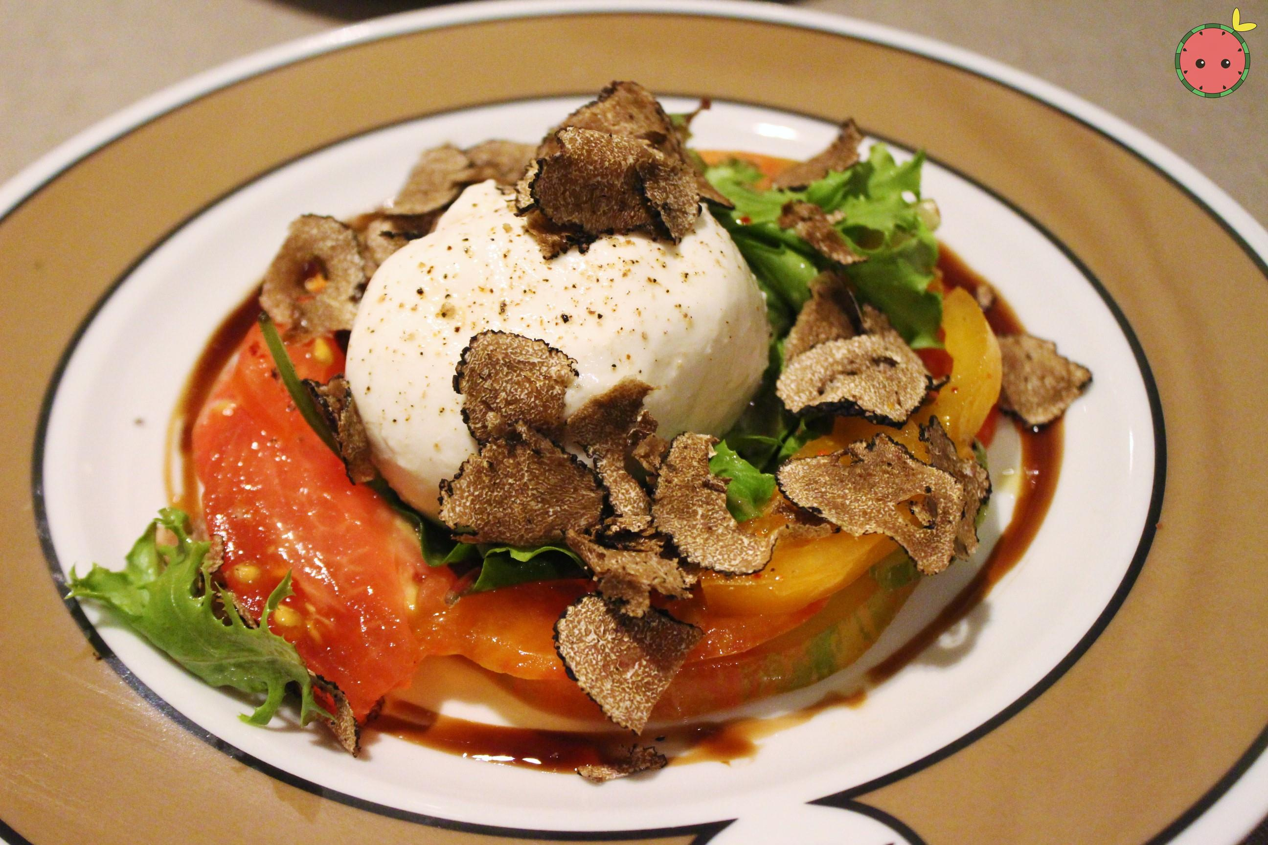 Burrata with tomatoes and truffle