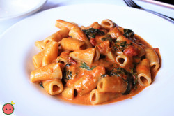Penne Capricciose  with Spinach, Roasted Red Peppers, Roasted Garlic, Tomato, & Cream Sauce