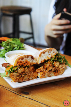 Shredded Chicken Farm Style Sandwich - Roasted onions, arugula, and harissa tahini