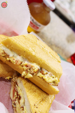 Small Scrambled Egg Sandwich_ Ham, cheese, onion, tomato