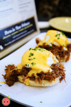 Eggs Cochon - Slow-Cooked, Apple-Braised Pork Debris served over a Buttermilk Biscuit, Topped with T