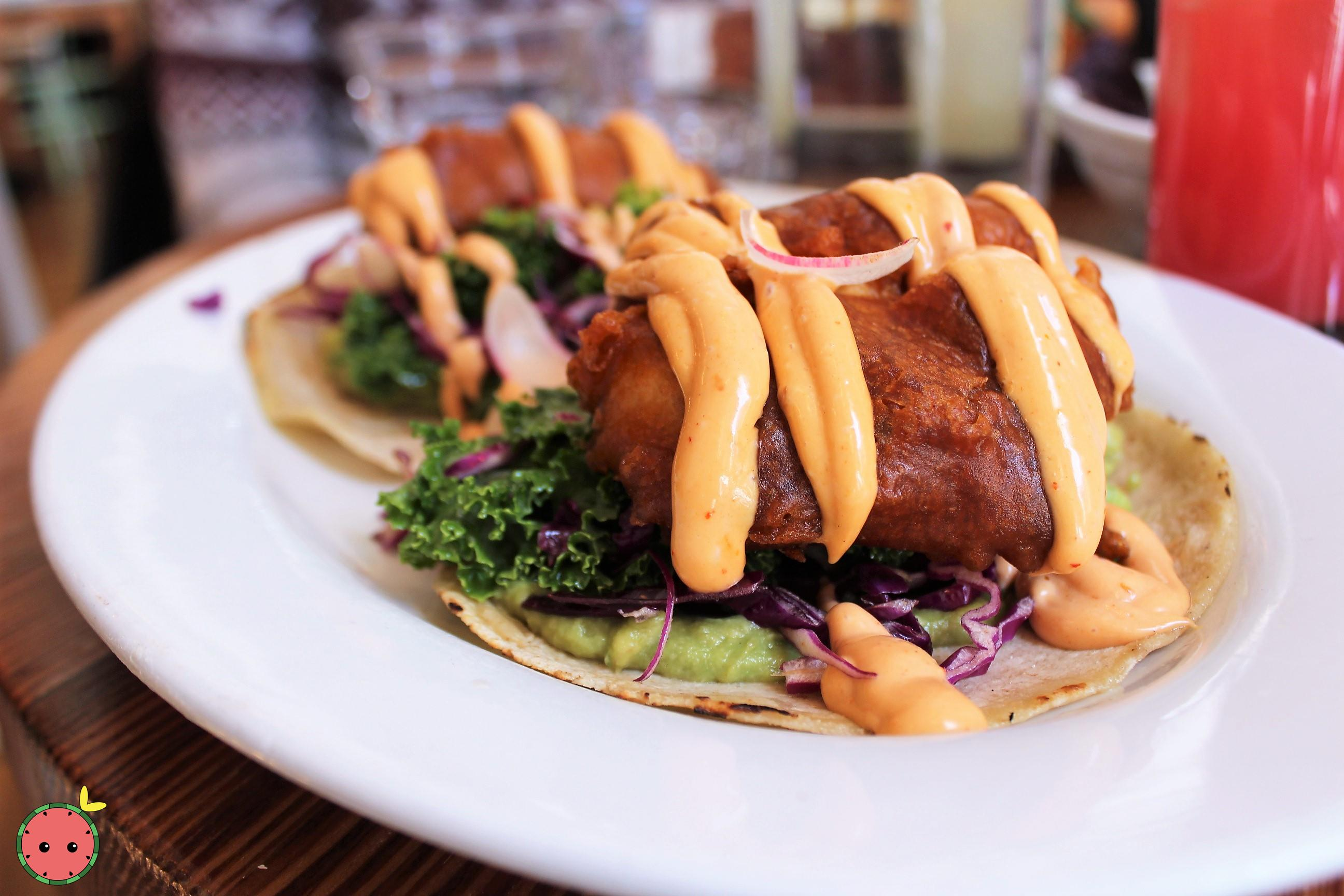 Crispy Fish Taco with cabbage, guacamole, and chipotle mayo