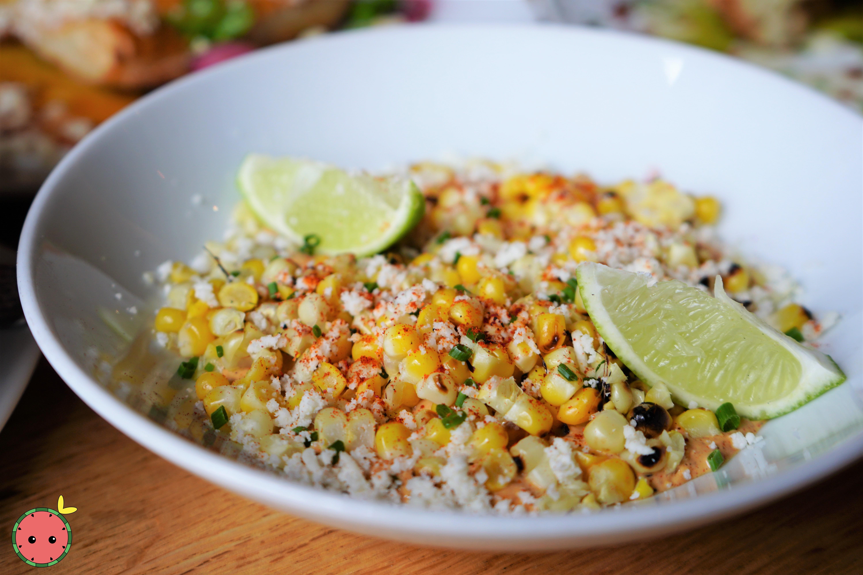 Grilled Corn with Cotija Cheese, Ancho Chili Creme, Lime, & Guajillo