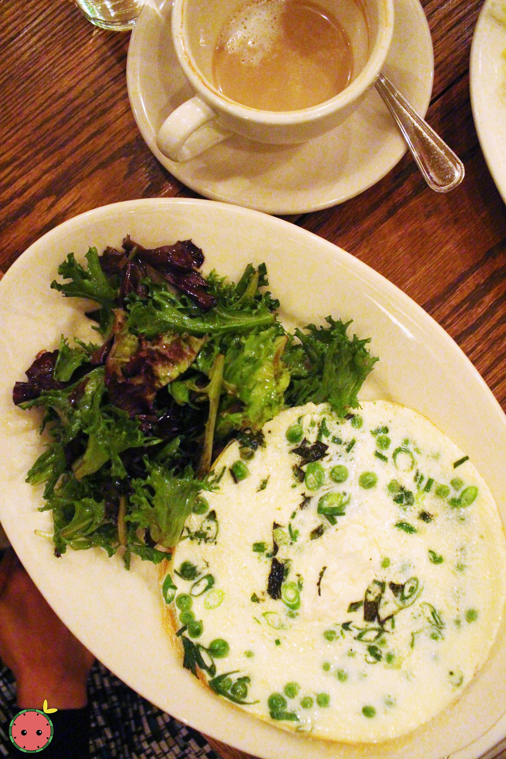 Open-Faced Egg White Omelet - Spring onions, english peas, herbs, and goat cheese with side salad