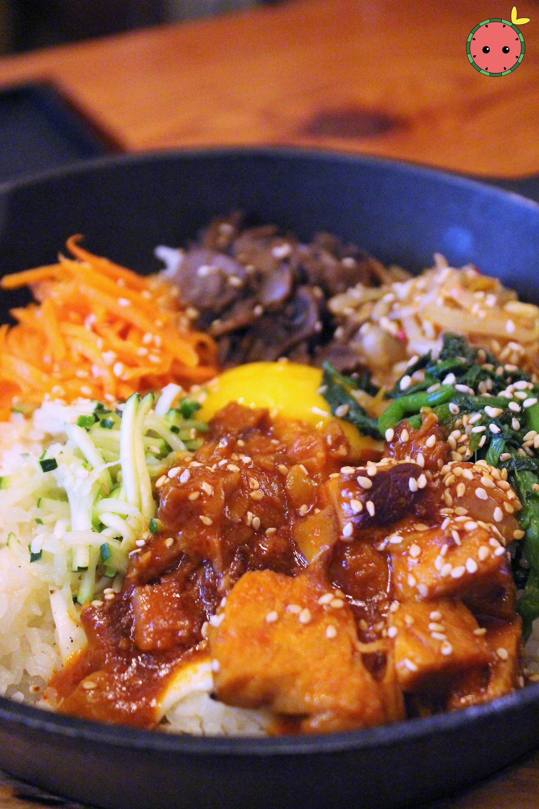 Spicy Pork Bibim-Bap - Traditional korean rice dish with pork, marinated vegetables, jidori fried eg