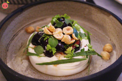 Burrata with pickled cherries, hazelnuts, and herbs