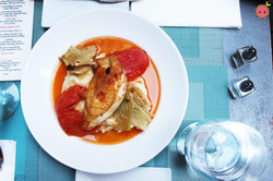 Free-range roasted chicken breast with mashed potatoes, braised fennel, tomato confit, & au jus