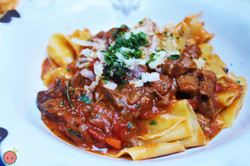 Pappardelle allo Spezzatino d'Agnello - Homemade pappardelle with slow-roasted lamb, olives, rosemar