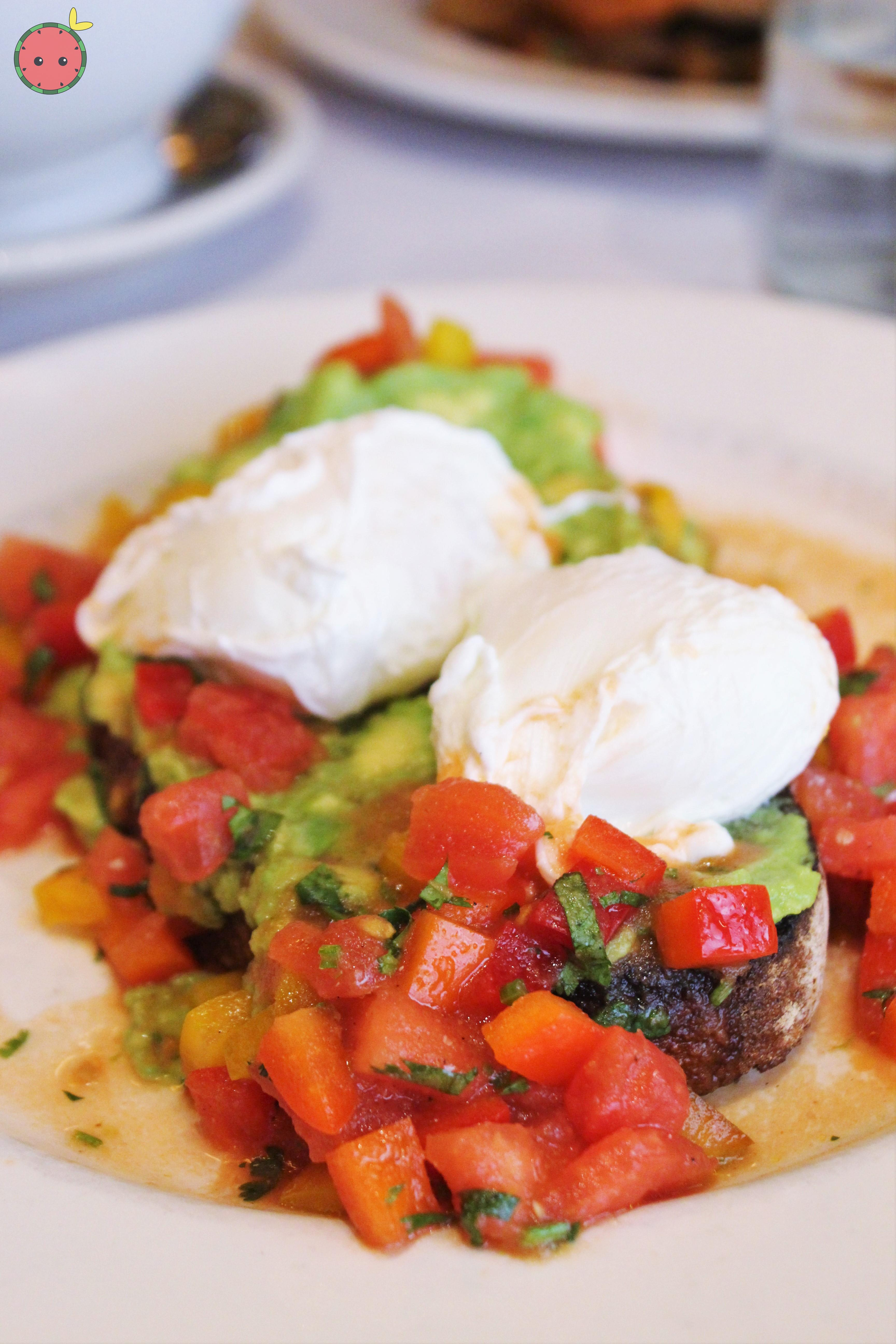 Avocado and poached eggs on toast with tomato-jalapeño salsa