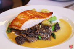 Pan roasted organic salmon with asparagus, chanterelles, new potatoes and lobster beurre blanc