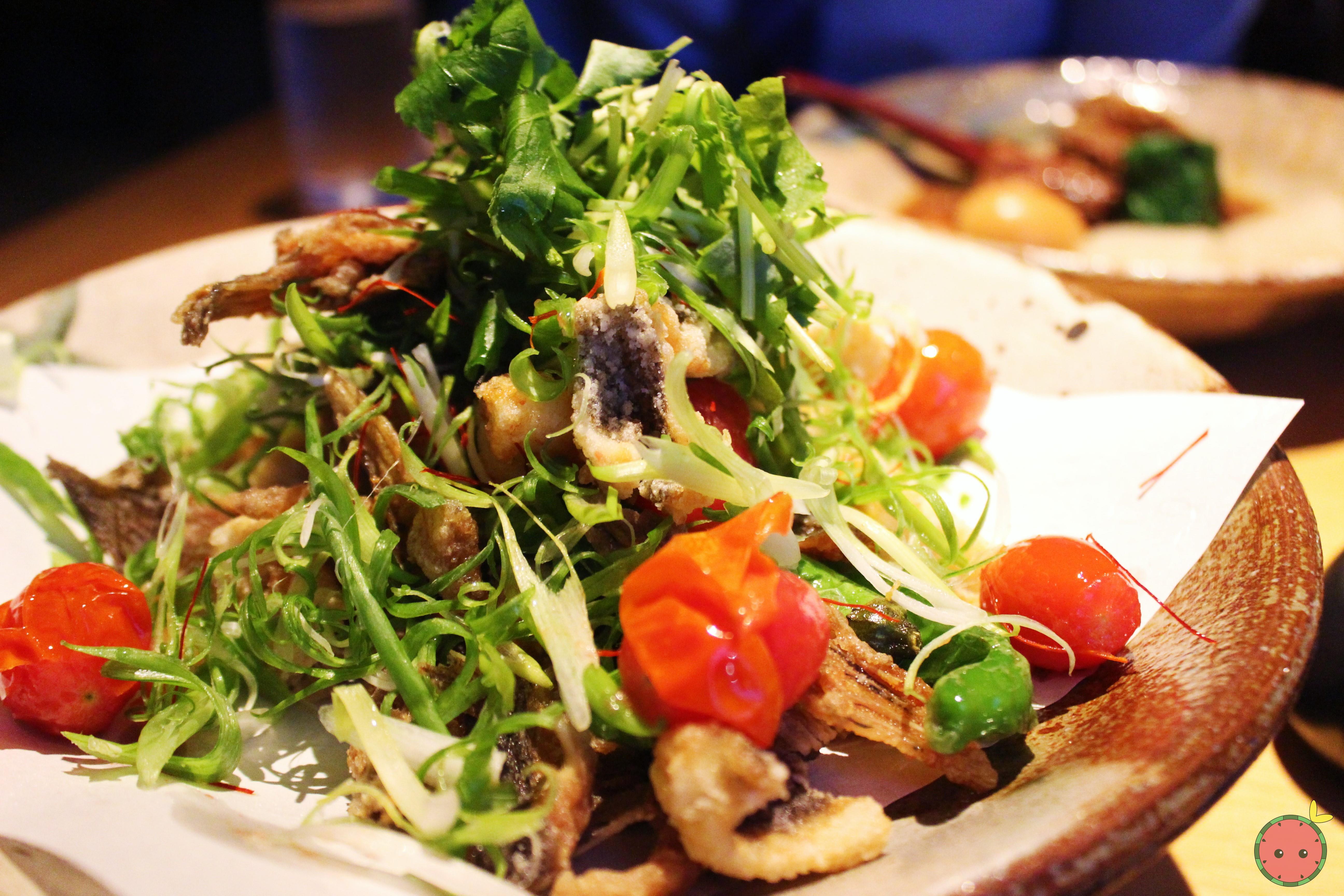 Karei Karaage - Seasoned flounder fried with shishito peppers, tomato, scallions, and its bones, wit