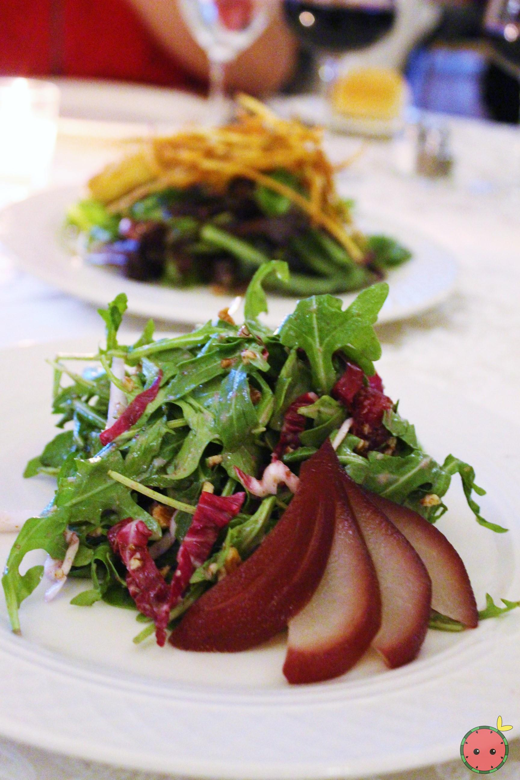 Tri-color lettuce with port wine poached pears, toasted pecans, and pear glaze