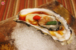 Fresh North Bay Oyster with onion, ponzu sauce, and goji berry