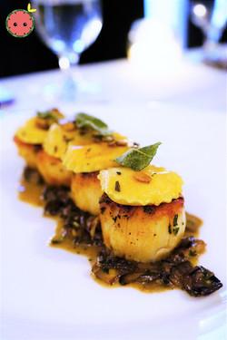 Scallops with Sweet Potato Ravioli, Mixed Mushrooms, & Pumpkin Seeds