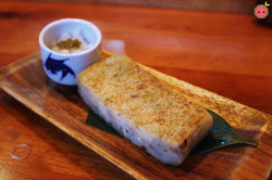 Daikon Mochi - Slightly grilled sticky rice cake mixed with grated daikon radish and burdock, with a