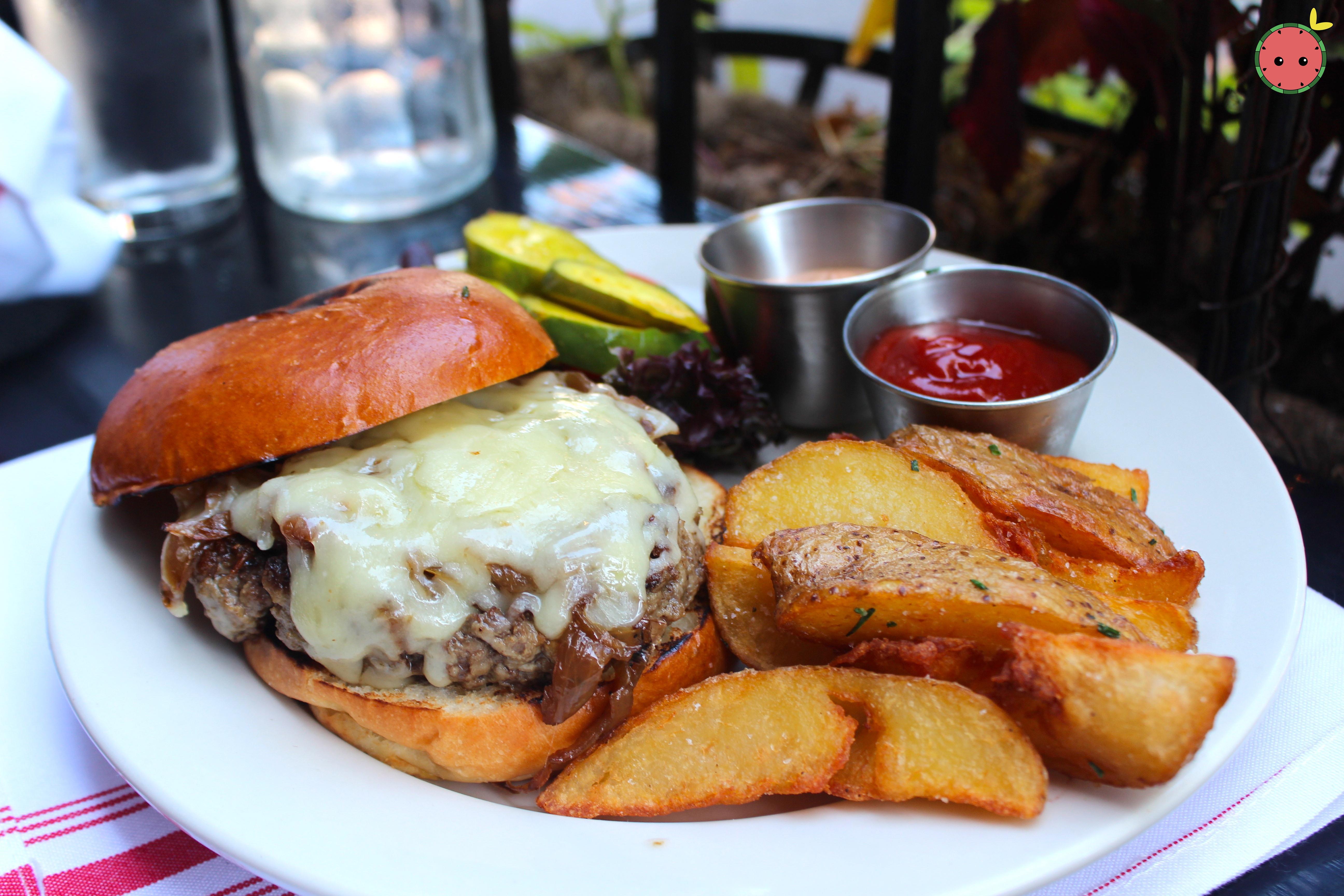Bone marrow & brisket burger with tarentaise cheese, carmelized onions, crispy potato wedges