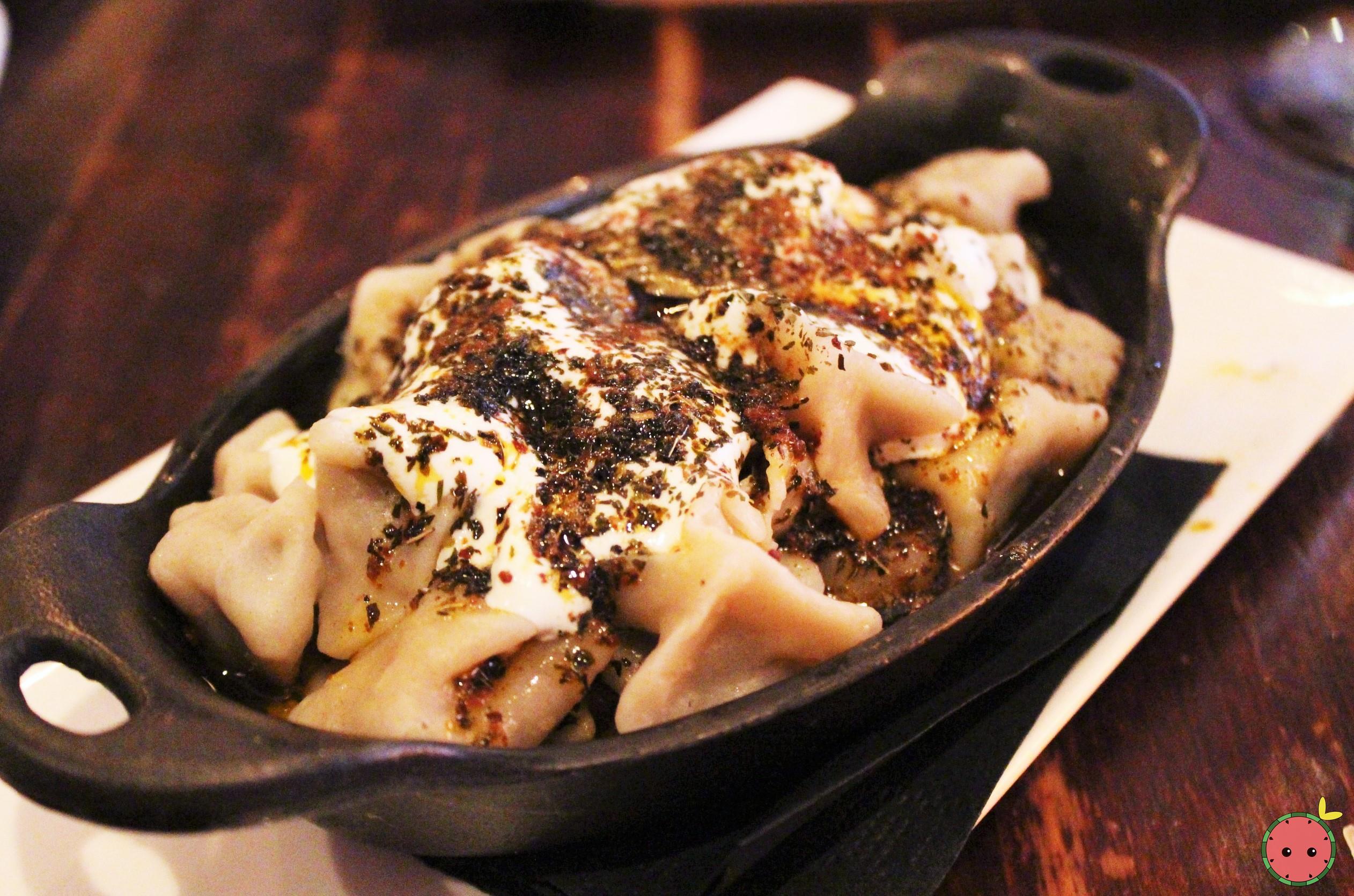 Manti - Turkish beef dumplings with yogurt, butter, dry herbs