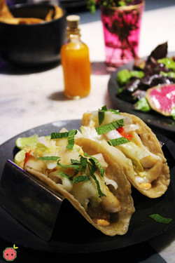 Griddled fish tacos, aioli, and cabbage-chili pickle