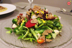 Raw and cooked vegetables with olive oil, lemon, and truffle