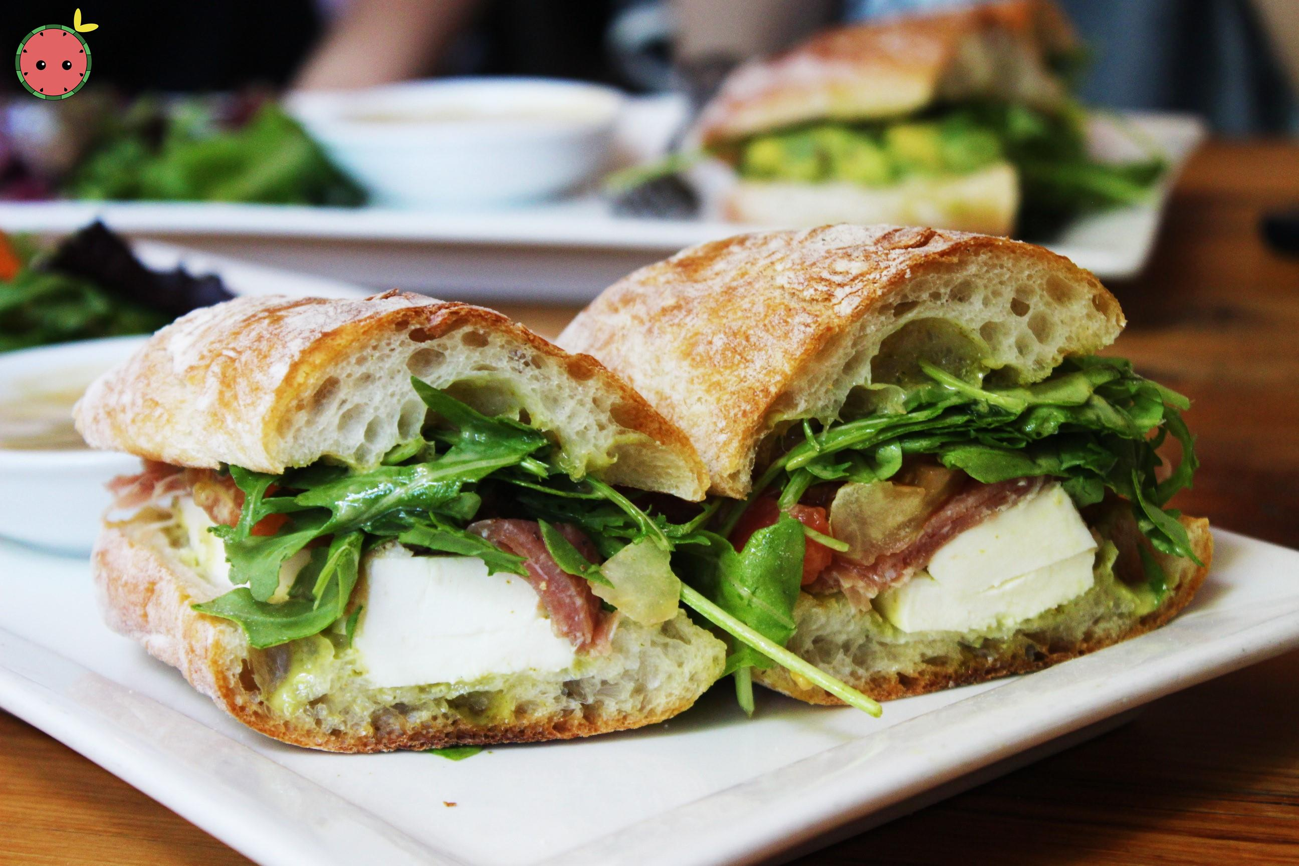 Mozzarella Farm Style Sandwich - Crushed tomatoes, arugula, prosciutto, and mint aioli