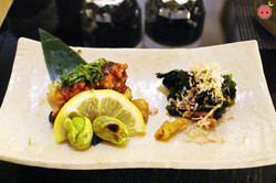 Left - Chicken thigh with moromiso and shiso leaf; Right - Seaweed, bonito flakes, chicken skin, and