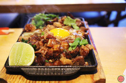 Sizzling Sisig - Pork head, chili, whole egg