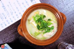 Shiizakana - Chicken and sake lees pot with spring onion, dropwort, deep-fried tofu, and carrot
