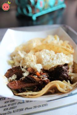 Short Rib Taco (slow braised short rib with tamarind slurry, bird's eye chili salsa, chicharrones, &