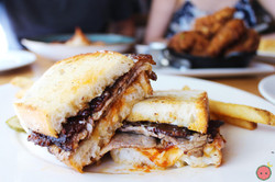 Smoked Brisket Sandwich - House pickles, smoky tomato jam, swiss cheese, grilled country bread, hous