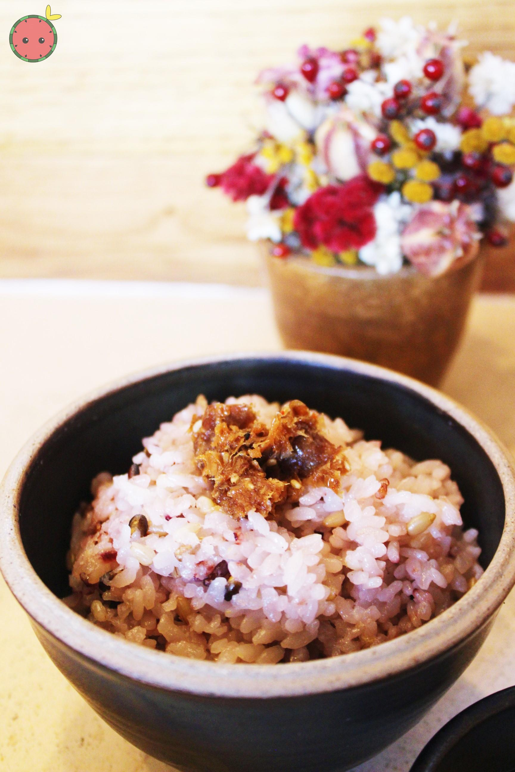 Six grain rice with bonito flakes soaked in house soy sauce and sesame oil