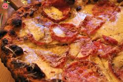 Spicy Honey Pizza (soppressata, provolone bechamel, house fior di latte, mozzarella, bees knees spic